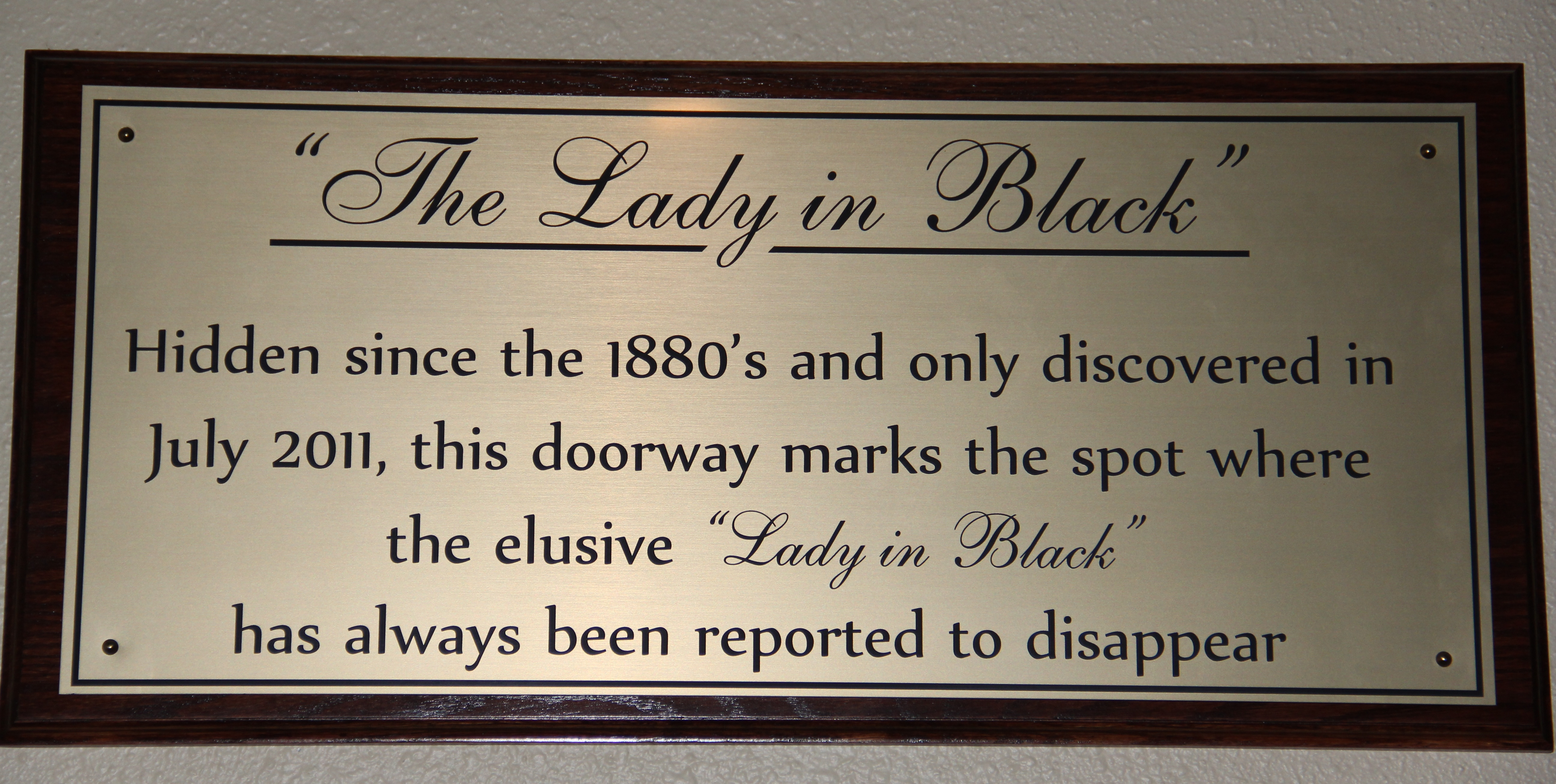 Lady in Black Sign