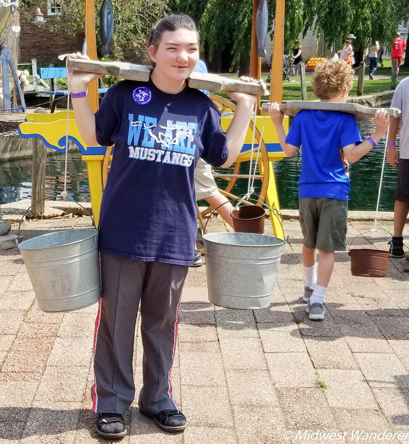 Carrying the water at Dutch Village