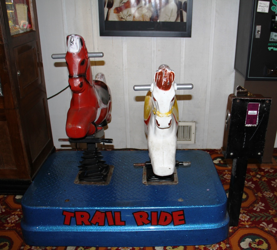 Coin-operated horses