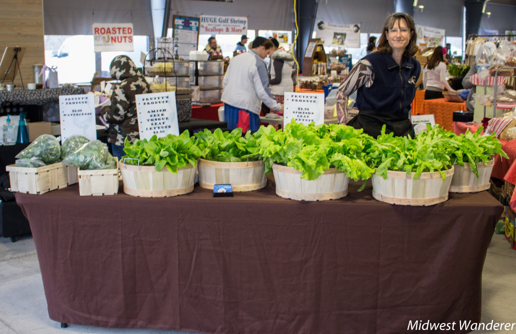 Robin Pruitt selling lettuce at the Farmers Market of the Ozarks