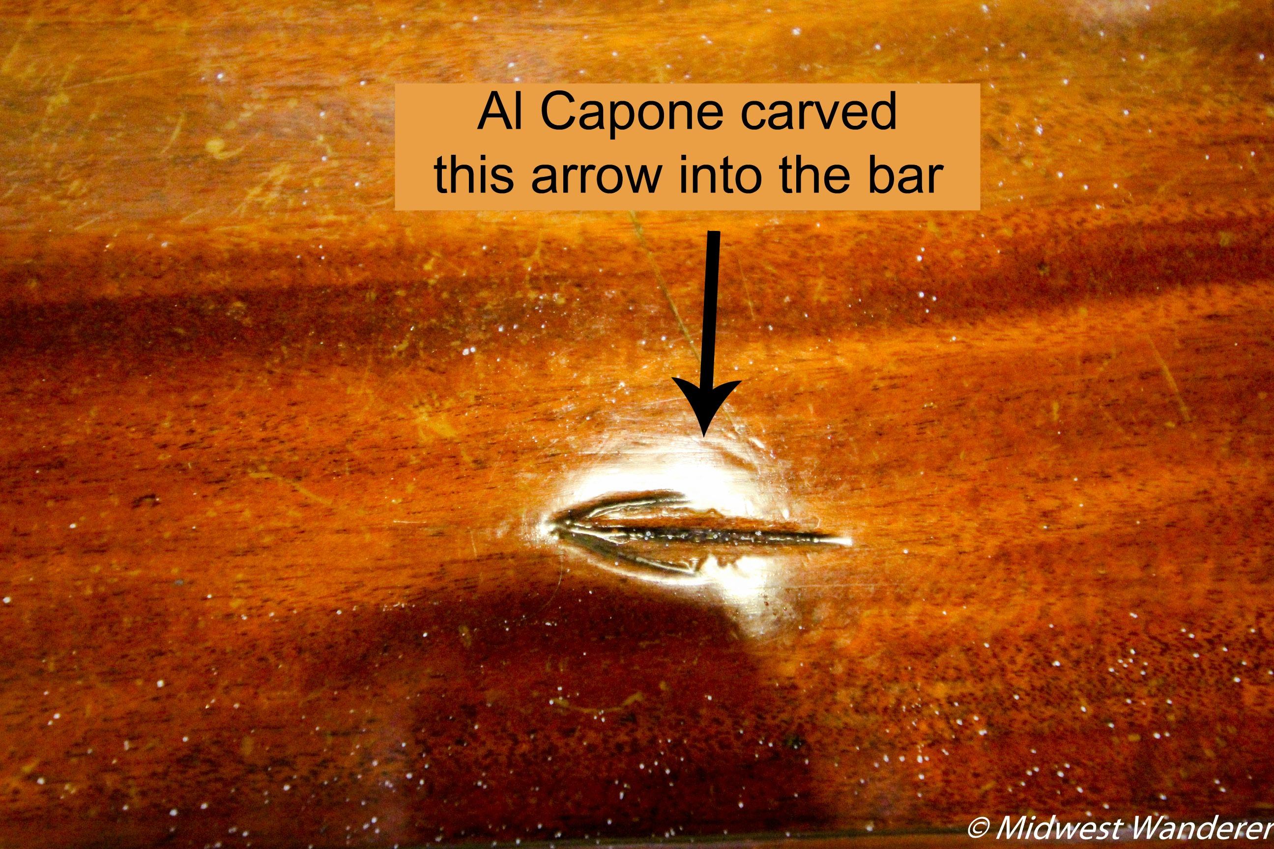 Al Capone carved arrow into bar