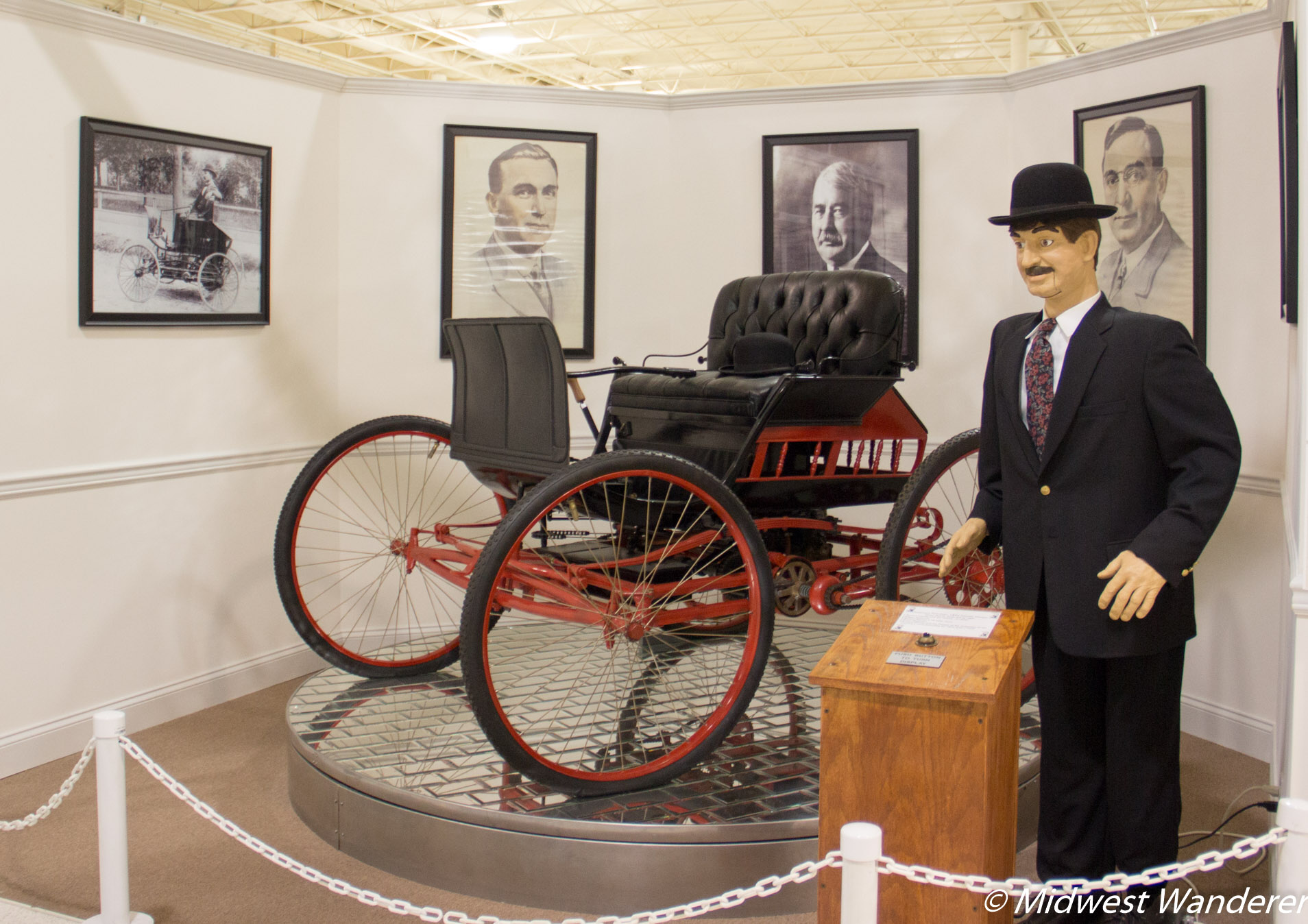 Likeness of Elwood Haynes and the first practical, purpose built automobile.