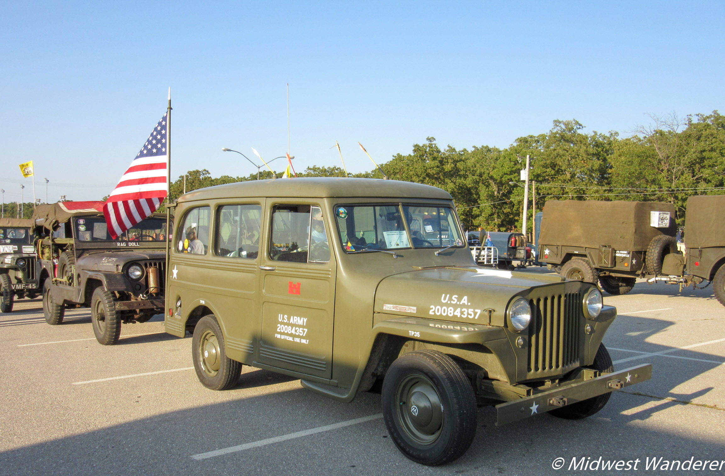 Antique military vehicle convoy along Route 66 at Fort Leonard Wood