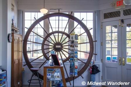 This image has an empty alt attribute; its file name is Howard-Steamboat-Museum-boat-wheel.jpg